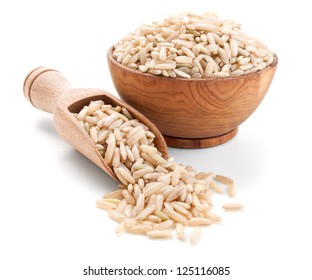 unpolished rice in a wooden bowl isolated on white background