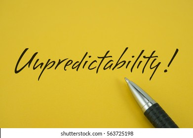 Unpredictability! note with pen on yellow background