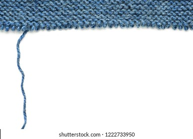 Unravelling knitted fabric on white background
