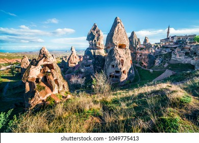 Unreal world of Cappadocia. Deep blue sky over Uchisar Castle. Bright morning scene of famous Uchisar village, district of Nevsehir Province in the Central Anatolia Region of Turkey, Asia.