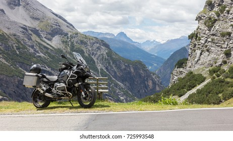 Unrecognisable motorcycle and driver in the Alps - Enjoying the scenery