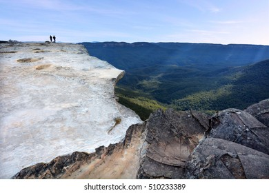 Unrecognisable people hikes on Lincoln Rock Lookout at sunset in the Blue Mountains National Park in the Blue Mountains region of New South Wales, Australia