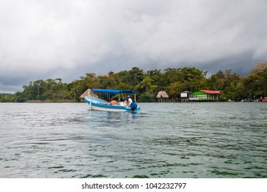Unrecognisable people on a motor boat on Rio Dulce, Guatemala,