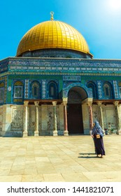 Unrecognisable veiled muslim woman at the dome of the rock