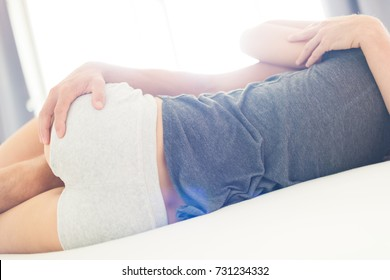 Unrecognisable young sensual couple in their bedroom, sex concept
