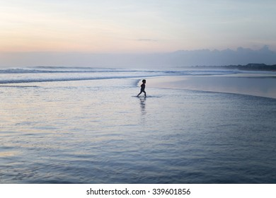 Unrecognizable boy playing on ocean beach