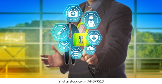Unrecognizable business man is unlocking healthcare data of a male employee. Concept for secure access to personal health records, electronic medical record and health care information exchange.