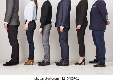 Unrecognizable business people profile in office. Professional team posing for photo, subordination concept, crop