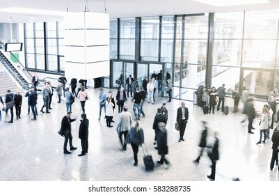 unrecognizable business people rushing in a modern trade fair hall