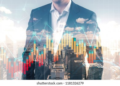 Unrecognizable businessman in dark suit standing over blurred city background and growing forex style graphs foreground. Stock market concept. Toned image double exposure mock up