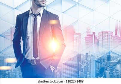 Unrecognizable businessman in dark suit standing over a morning city background. Geometric pattern foreground. Toned image double exposure mock up