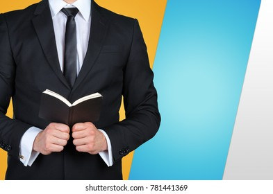 Unrecognizable businessman holding  a book