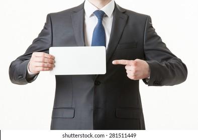 Unrecognizable businessman holding an empty paper card, closeup shot