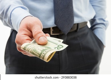 Unrecognizable businessman holding twenty dollars - closeup shot