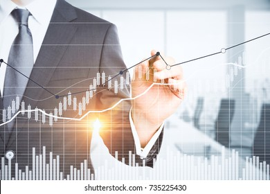Unrecognizable businessman pointing at abstract business chart on blurry office interior background. Close up. Economy concept. Double exposure