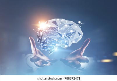 Unrecognizable businessman s hands holding a brain hologram. A blurred blue background. Toned image double exposure mock up.