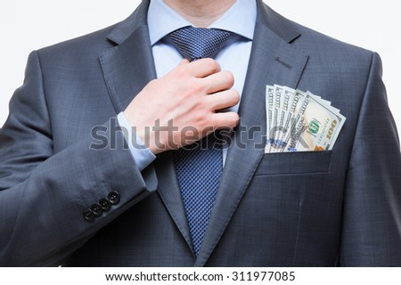 b1334e51de62 Unrecognizable businessman setting the tie straight with money in the pocket