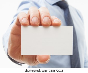 Unrecognizable businessman showing business card - closeup shot