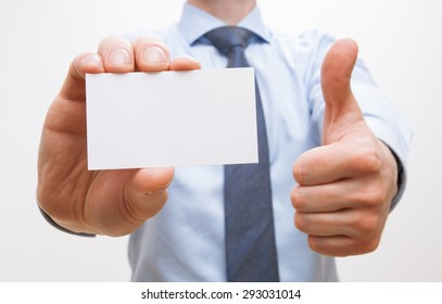Unrecognizable businessman showing  visiting and thumb up sign, white background
