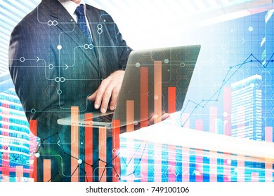 Unrecognizable businessman using laptop on city background with abstract digital pattern. Finance, innovation and analytics concept. Double exposure