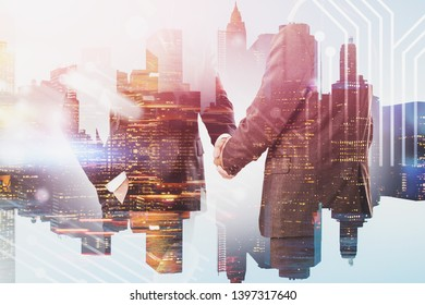 Unrecognizable businessmen shaking hands over cityscape background with circuit interface. Concept of technological startup and partnership. Toned image double exposure