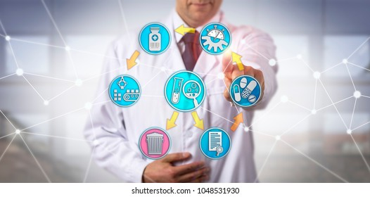 Unrecognizable clinical researcher engaged in pharmacovigilance audit via touch screen. Pharmaceutical industry concept for regulatory vigilance authority, drug safety, safeguarding, compliance.