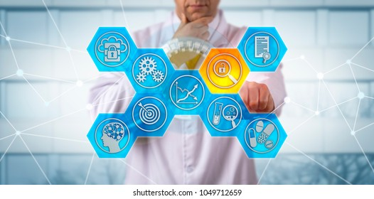 Unrecognizable clinician pondering a data integrity risk, while safeguarding drug quality. Pharma concept for laboratory automation, increased regulatory scrutiny, vulnerability, GMP compliance.