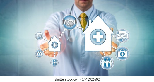 Unrecognizable clinician presenting a deal between a small hospital and a larger health care provider organization. Concept for healthcare mergers and acquisitions, economy of scale, consolidation.