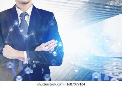 Unrecognizable confident businessman standing in modern city with double exposure of blurry financial graph. Concept of stock market and investment. Toned image