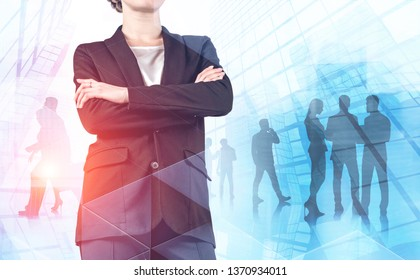 Unrecognizable confident businesswoman standing with crossed arms over abstract skyscrapers background with her team members. Leadership concept. Toned image double exposure