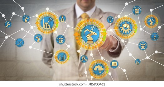 Unrecognizable corporate manager exchanging data between networked cyber manufacturing assets. IT concept for cyber-physical systems, CPS, cyber-manufacturing, Internet of things, reconfigurability.