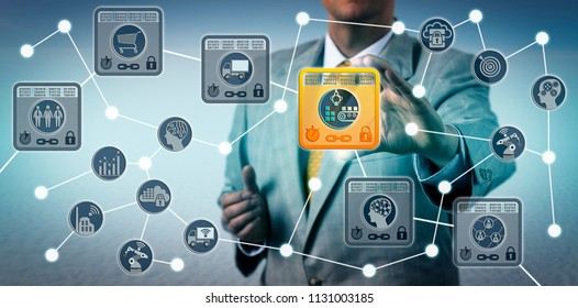 Unrecognizable corporate manager securing data integrity of supply chain via internet of things solution based on blockchain technology. Information technology concept for IoT and distributed ledger.