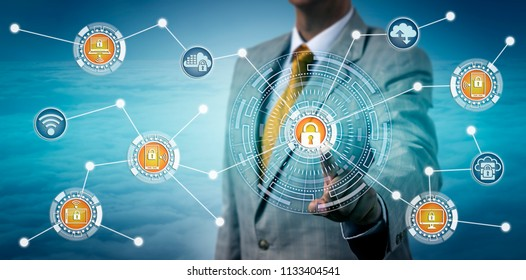 Unrecognizable cybersecurity specialist consolidating device management via touch screen. Information technology concept for digital mobility, remote access control, connectivity, data security.