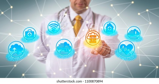Unrecognizable doctor of medicine accessing secure data on cloud server. Healthcare information technology concept for compliance in the cloud, cloud-based IT services, cloud security, cybersecurity.