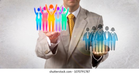 Unrecognizable entrepreneur elevating a cheering multicultural work team over a monocultural group of white collar workers. Concept for team success, equal opportunity, multiculturalism, diversity.