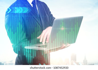 Unrecognizable european businessman using laptop on abstract creative city background with forex chart. Technology, communication and finance concept. Double exposure