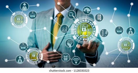 Unrecognizable executive using smartphone telematics to assess driver behavior. Technology and insurance industry concept for data collection via smart portable devices, connected car, connectivity.