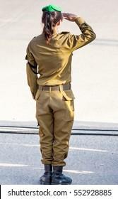 unrecognizable female soldier saluting