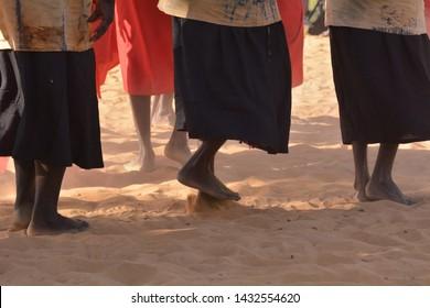 Unrecognizable group of Indigenous Australians aboriginal women dancing a cultural ceremony dance.