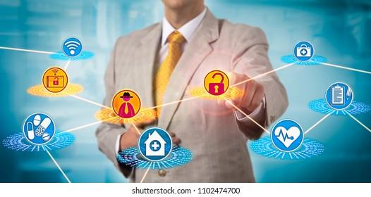 Unrecognizable healthcare administrator subjected to cybercrime. Health care IT concept for advanced persistent threat, hacker attack via portable device, malware, data loss, network incident, APT.