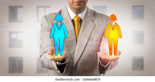 Unrecognizable human resources manager ranking two female employees on the same level in his hands. Staffing concept for cultural diversity, equal opportunity, succession planning, career coaching.