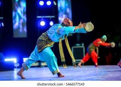 Unrecognizable Indonesian folkloric dancer in performance