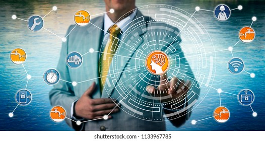 Unrecognizable industrial manager monitoring a smart water grid via artificial intelligence and IoT connectivity. Technology and industry concept for internet of things and intelligent water network.