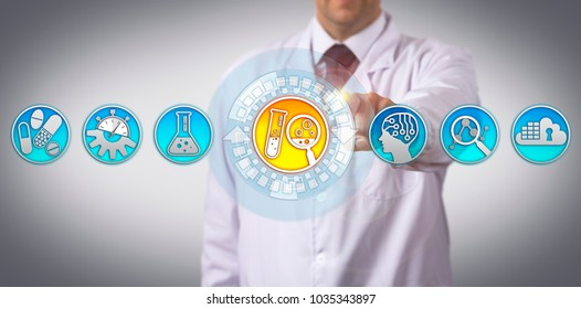 Unrecognizable industrial scientist is initiating the drug discovery process via touch screen interface. Pharmaceutical industry concept for research and development aided by artificial intelligence.