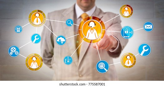 Unrecognizable male corporate user contacting customer service representatives via touch onscreen. Business and technology concept for IT help desk, after sales service, tech support and call center.