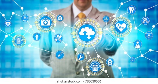 Unrecognizable male health care administrator is transferring data via software as a service application. Healthcare IT concept for medical practice management system and health information exchange.