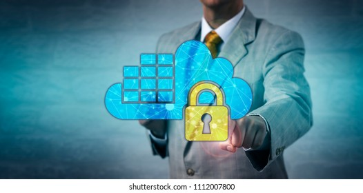 Unrecognizable male network administrator locking a cloud container application. Information technology concept for data security, assurance, regulatory compliance, virtualized operating system.