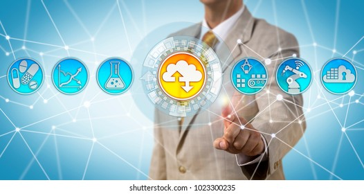 Unrecognizable male pharmaceutical business manager adopting a cloud-first strategy. Industry concept for outsourcing of critical manufacturing functions, quality metrics initiative, efficiency.