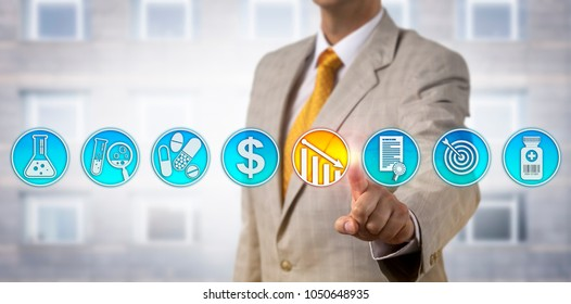 Unrecognizable male pharmaceutical business manager is lowering drug price via touch screen interface. Pharma industry marketing concept for competitive pricing strategy for newly approved drugs.