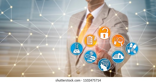 Unrecognizable male pharmaceutical executive securely accessing data file on drug discovery via internet. Pharma industry IT security concept for electronic records keeping and data management.